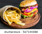 burger and french fries on a... | Shutterstock . vector #567144388
