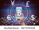 holding smart phone showing the ... | Shutterstock . vector #567154318