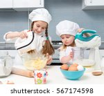 two funny little girls in chef... | Shutterstock . vector #567174598