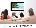 family watching television at... | Shutterstock . vector #567208228
