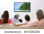 family watching television at... | Shutterstock . vector #567208258