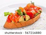 italian tost  bruschetta on a... | Shutterstock . vector #567216880