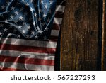usa flag on a wood surface | Shutterstock . vector #567227293