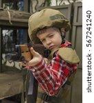 boy in soldier uniform takes... | Shutterstock . vector #567241240