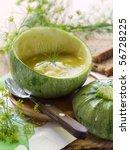 Zucchini  creamy soup in zucchini - stock photo