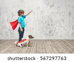 little hero with dog indoors | Shutterstock . vector #567297763