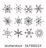 Hand-drawn doodle snowflakes set.