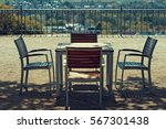A Table And 4 Chairs On A...