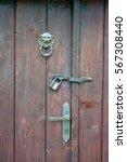 beautiful old door knocker | Shutterstock . vector #567308440
