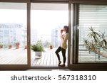 Woman Relaxing On Balcony...