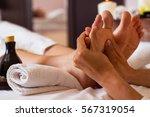 massage of human foot in spa...   Shutterstock . vector #567319054