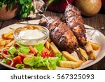 grilled shish kebab served with ... | Shutterstock . vector #567325093