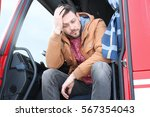 driver in cabin of big modern... | Shutterstock . vector #567354043