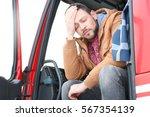 driver in cabin of big modern... | Shutterstock . vector #567354139