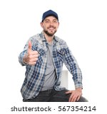 Small photo of Long-haul truck driver on white background