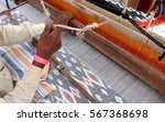 Worker Weaving Hand Loom India...