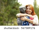soldier reunited with wife in...   Shutterstock . vector #567389176