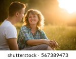 mother with her adult son... | Shutterstock . vector #567389473