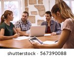 young business woman with her... | Shutterstock . vector #567390088