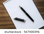 opened notepad with pen  small...   Shutterstock . vector #567400396