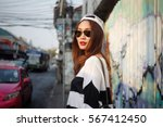asian woman on street | Shutterstock . vector #567412450
