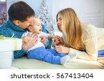 happy family at xmas morning | Shutterstock . vector #567413404