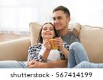 happy couple with hot drink on... | Shutterstock . vector #567414199