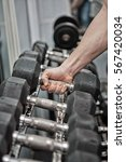 man picking a dumbbell in the... | Shutterstock . vector #567420034