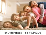 large group of children lying... | Shutterstock . vector #567424306