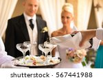 waiter pouring champagne for... | Shutterstock . vector #567441988