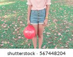 retro style of girl holds a red ... | Shutterstock . vector #567448204