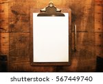 old clipboard with blank white... | Shutterstock . vector #567449740