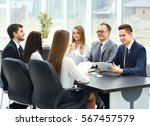 meeting business partners in a... | Shutterstock . vector #567457579