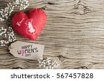 happy womens day on brown paper ...   Shutterstock . vector #567457828