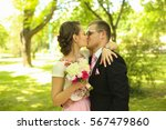 young couple posing in the park | Shutterstock . vector #567479860