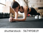 serious young sportswoman doing ... | Shutterstock . vector #567493819