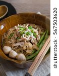 Small photo of Rice Vermicelli in thicken soup with shred chicken and morning glory in a brown bowl on the wooden table.