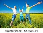 happy people is jumping in field   Shutterstock . vector #56750854