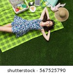 young smiling woman relaxing... | Shutterstock . vector #567525790
