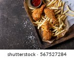 fried chicken legs with french... | Shutterstock . vector #567527284