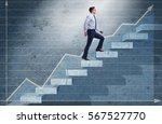 young businessman climbing... | Shutterstock . vector #567527770