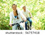 photo of happy woman riding... | Shutterstock . vector #56757418