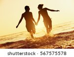 happy couple runs to sunset sea.... | Shutterstock . vector #567575578