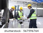 workers in uniform in cnc... | Shutterstock . vector #567596764