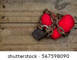 red heart tied with rusty chain ... | Shutterstock . vector #567598090