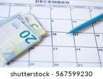 euro banknotes and a calendar.... | Shutterstock . vector #567599230