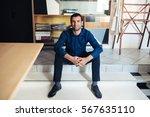 smiling entrepreneur sitting in ... | Shutterstock . vector #567635110