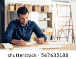focused businessman writing on...   Shutterstock . vector #567635188