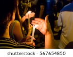 Group Of People Holding Candle...