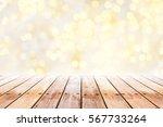 empty wooden table with golden... | Shutterstock . vector #567733264